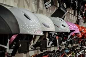 Ski helmets on shelf