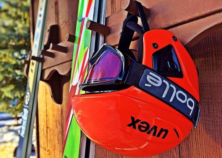 Helmet hanging on ski rack