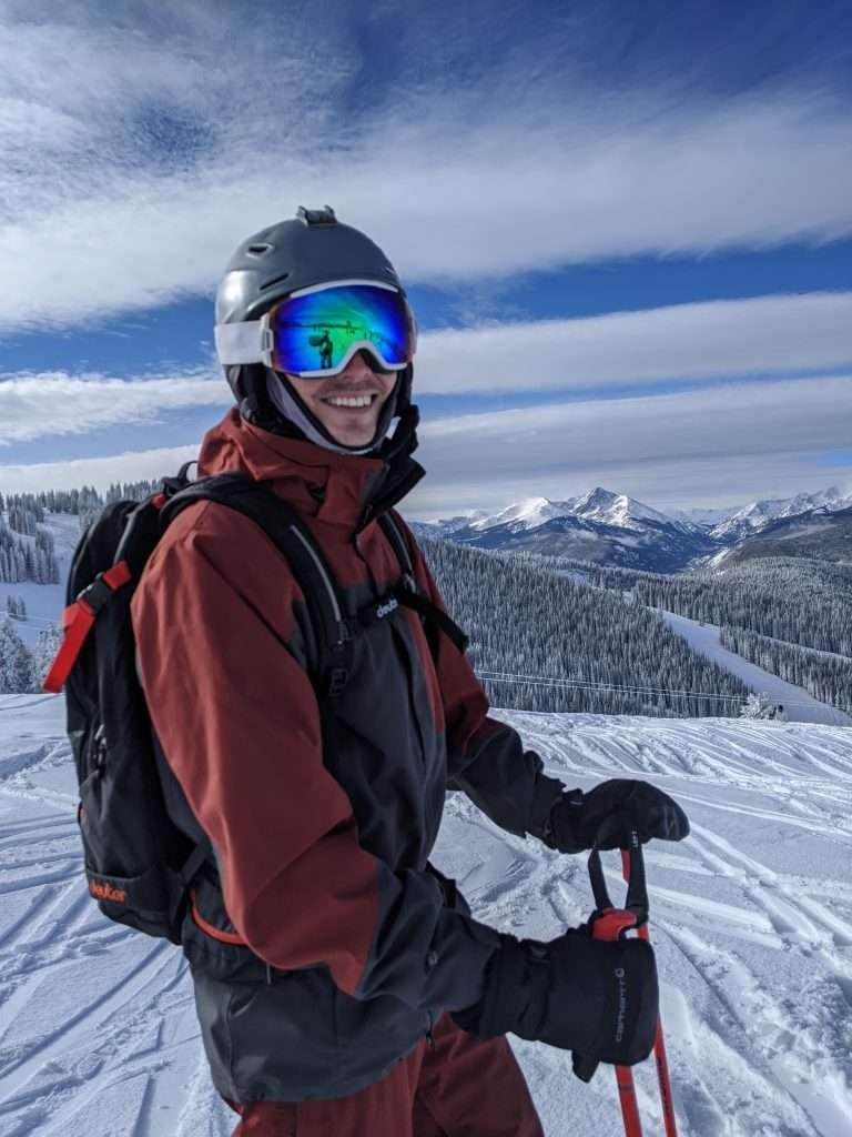 Skier smiling in nice ski jacket