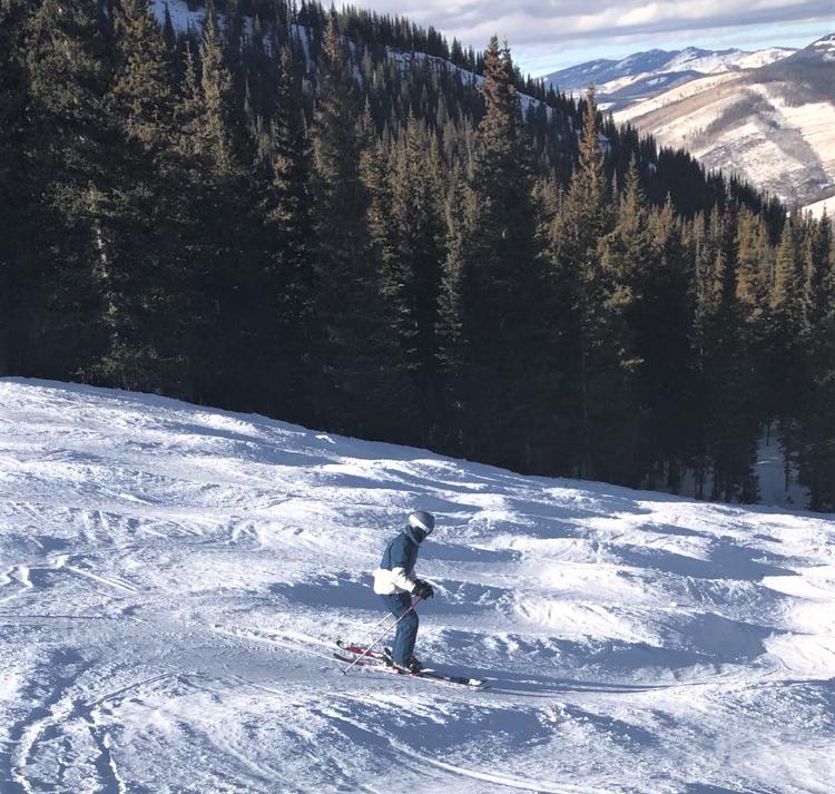 Skier starting a mogul run