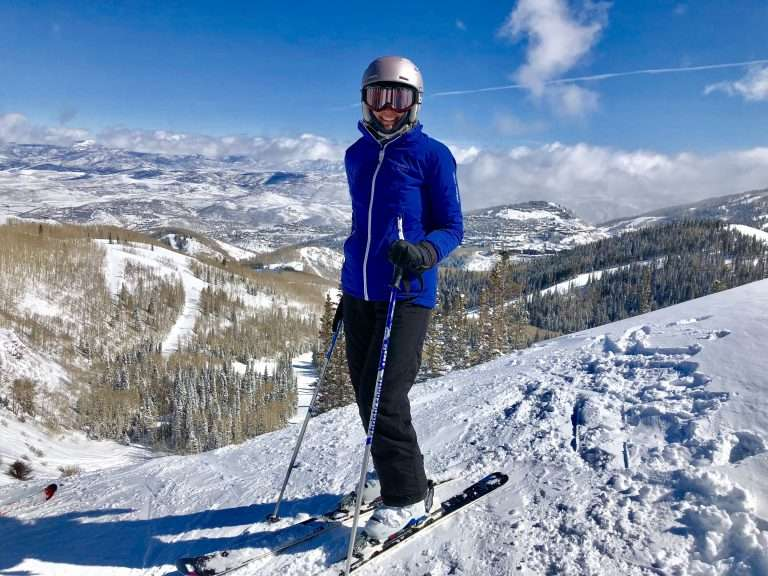 Skier in a bright purple ski jacket