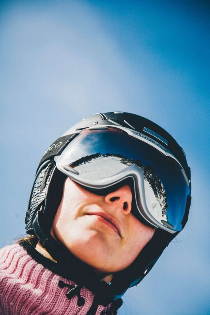 Up close shot of woman with ski goggles on