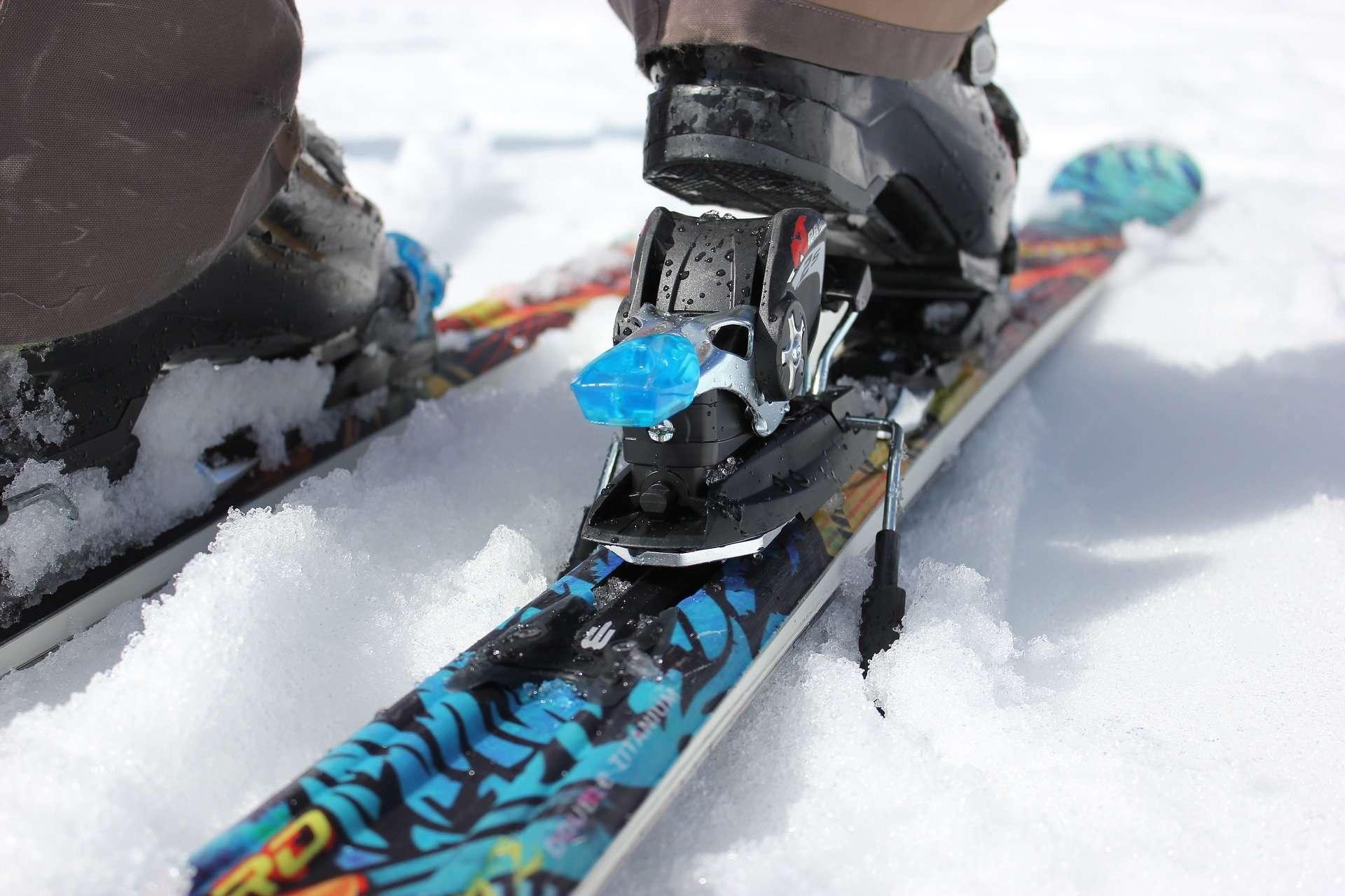 Skier locking into ski binding