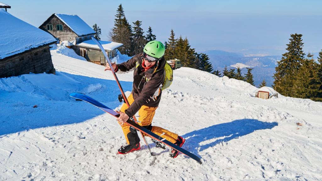 Skier dropping skis