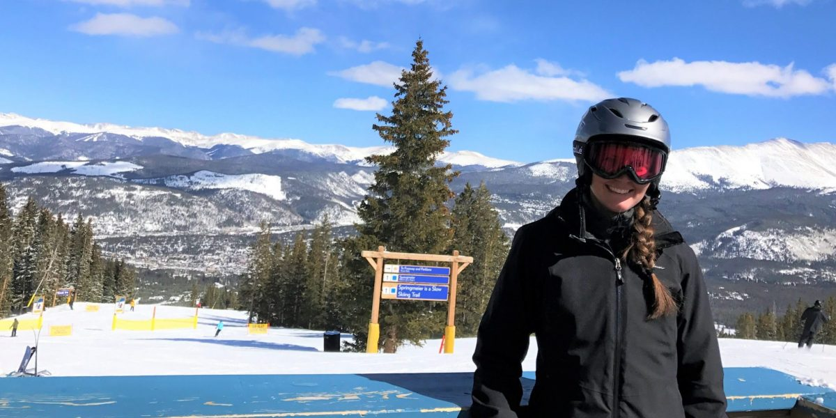 Skier smiling after skiing blue run for the first time