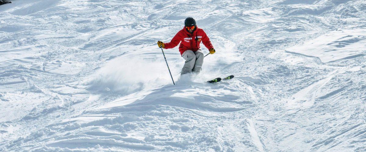 Person skiing moguls