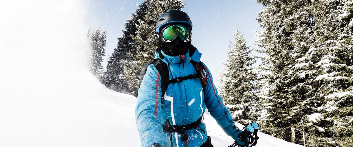 Skier in blue ski jacket with GoPro