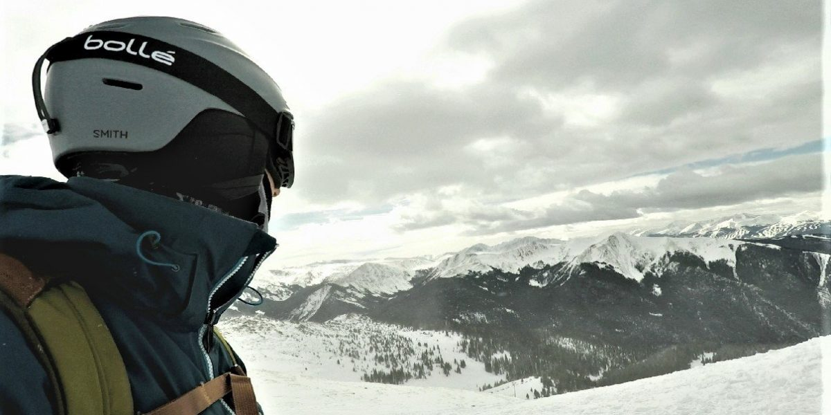 Skier with goggles strapped onto ski helmet