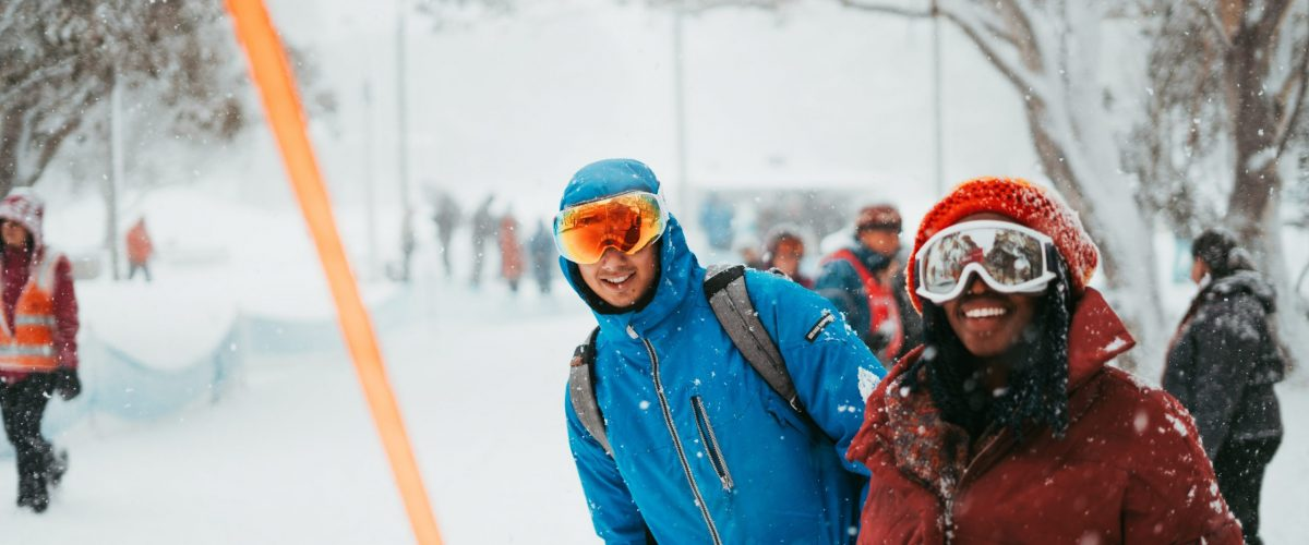 Two People Smiling in Ski Goggles