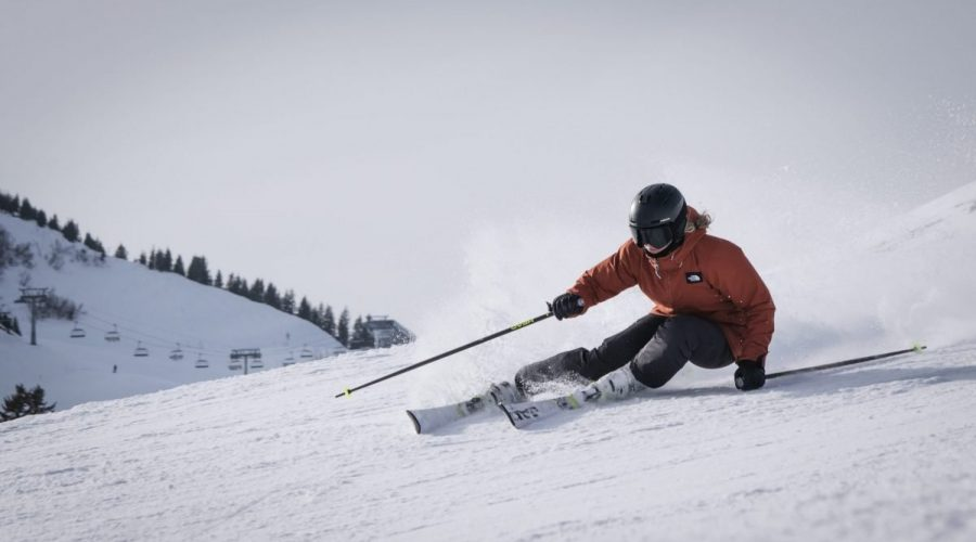 Skier carving down slope