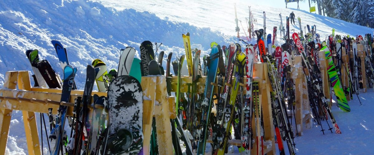 Outdoor ski rack lined with skis