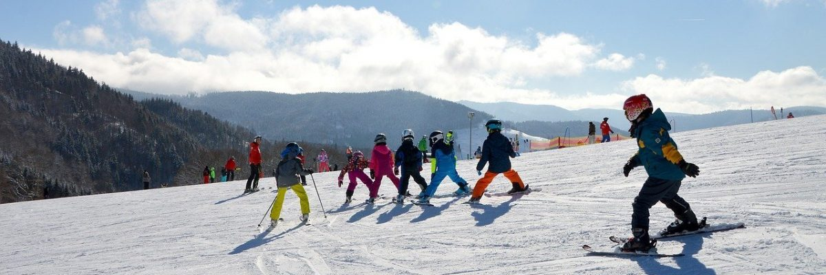 Group of children skiing together in a lesson