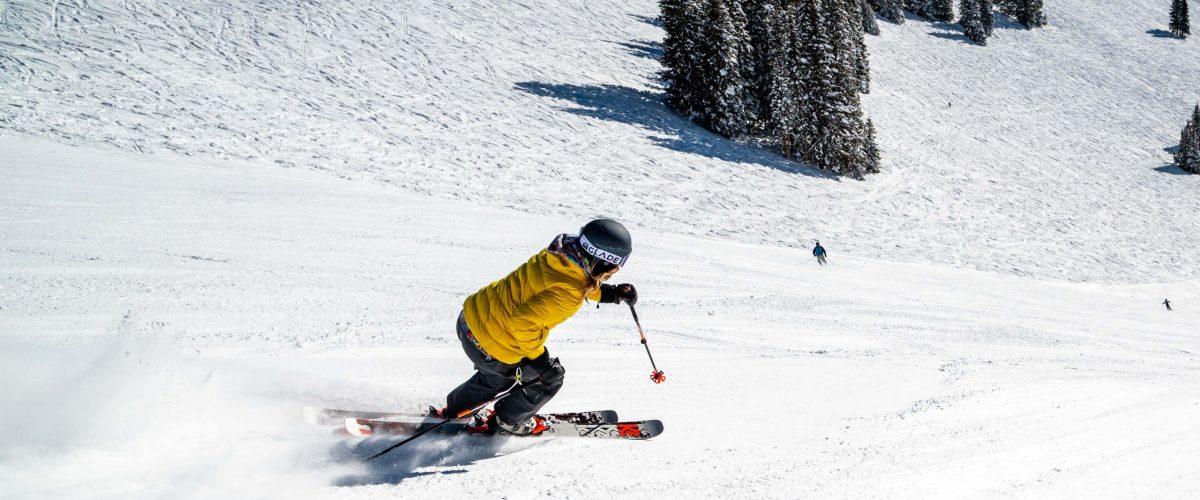 Woman skiing down black diamond run
