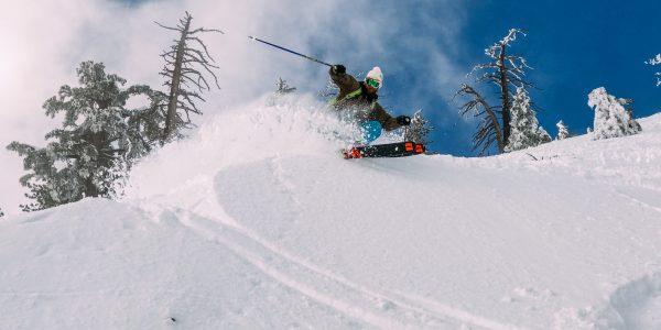 Skier spraying snow