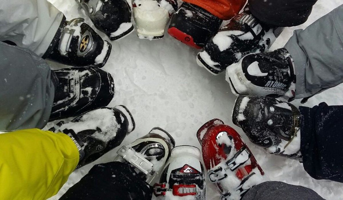Skiers forming a circle with their ski boots