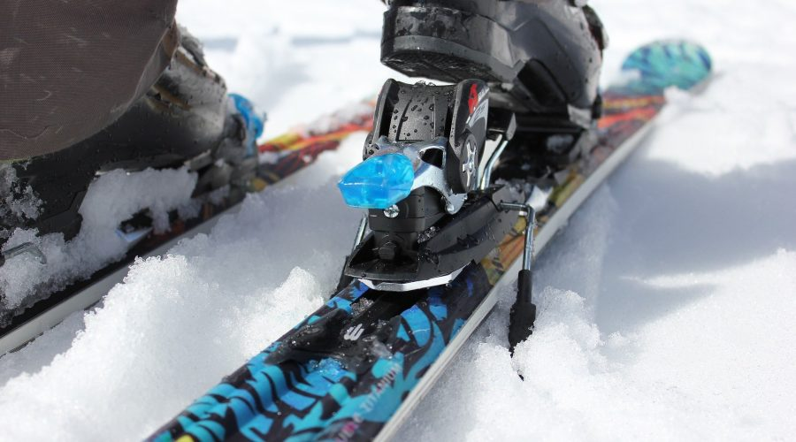 Skier locking into ski binding