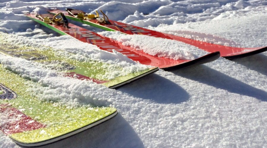 Two pairs of waxed skis on snow