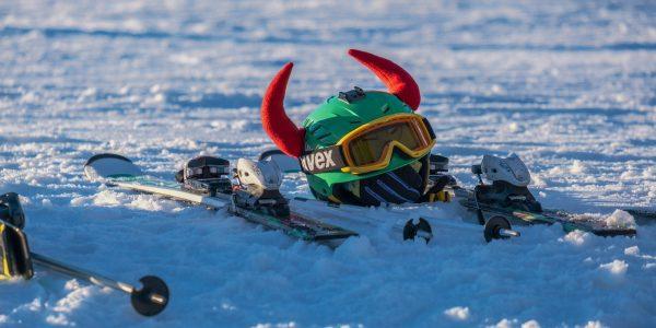 Fun kids ski helmet on the snow